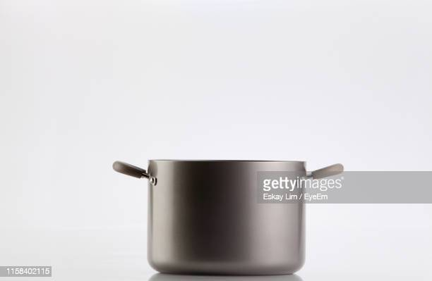 close-up of saucepan over white background - cooking pan stock pictures, royalty-free photos & images