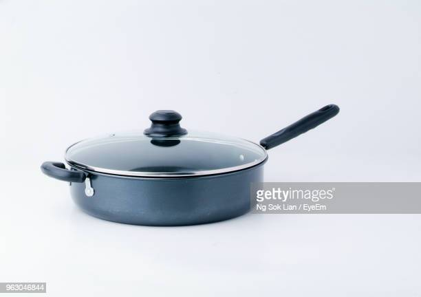 close-up of saucepan over white background - lid stock photos and pictures