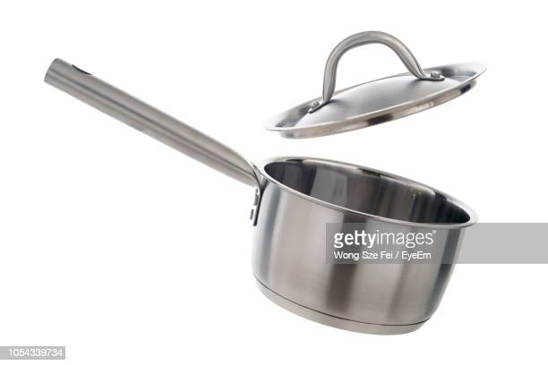 close-up of saucepan with lid against white background - cooking pan stock pictures, royalty-free photos & images