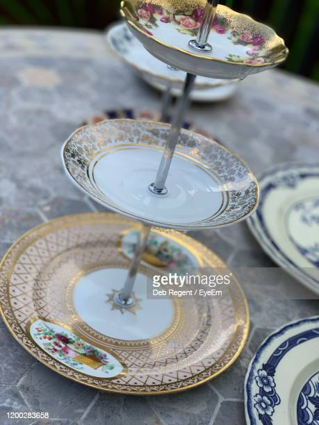 close-up of saucers on table - cakestand stock pictures, royalty-free photos & images