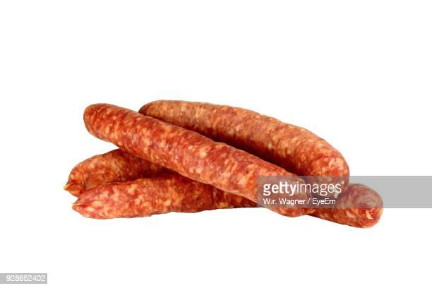 Close-Up Of Sausages Against White Background