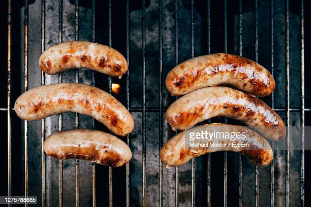 close-up of sausages on barbecue grill - sausage stock pictures, royalty-free photos & images