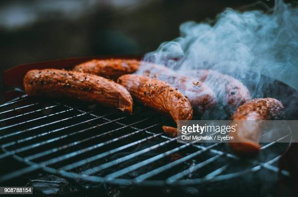 close-up of sausages on barbecue grill - metal grate stock photos and pictures