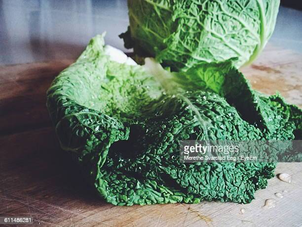 Close-Up Of Savoy Cabbage On Cutting Board