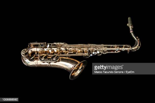 Close-Up Of Saxophone Against Black Background