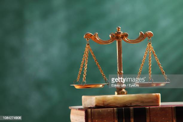 close-up of scales of justice - equal arm balance stock pictures, royalty-free photos & images