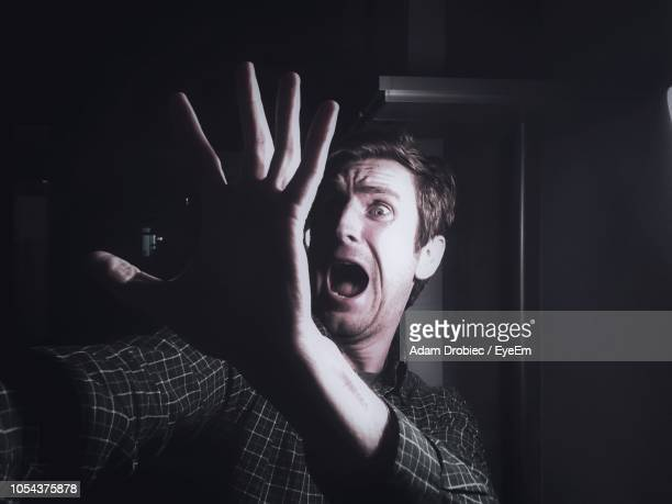 close-up of scared mature man at home - fear stock pictures, royalty-free photos & images