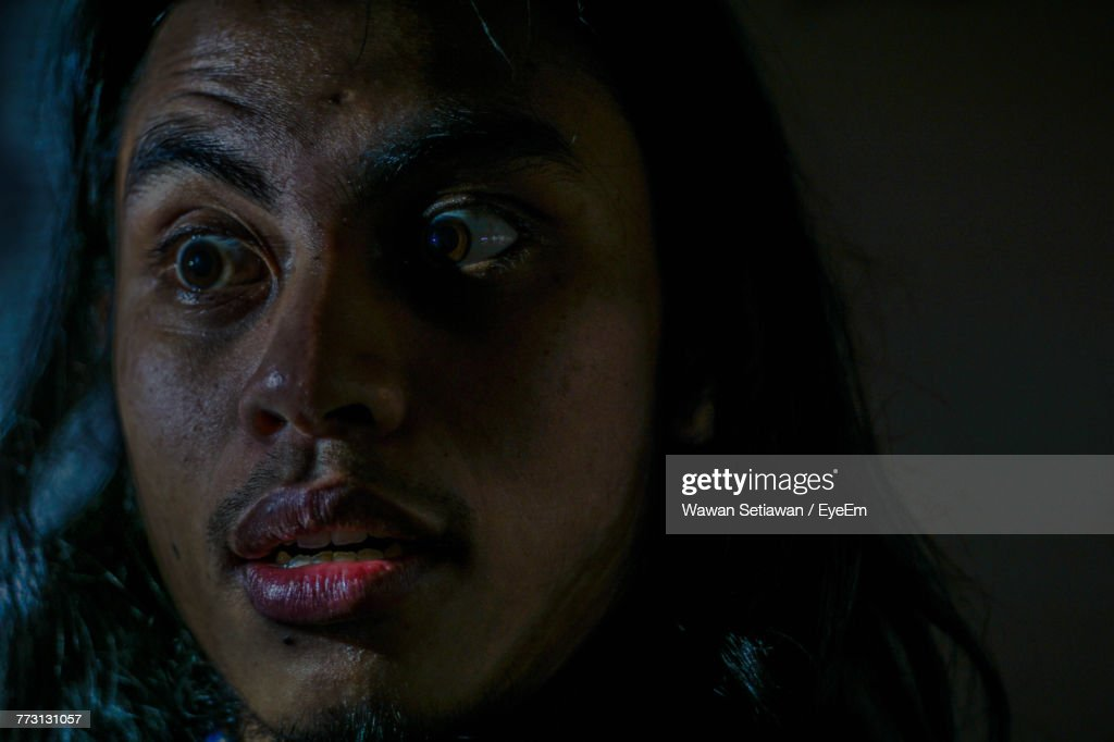 Close-Up Of Scared Young Man Looking Away : Photo