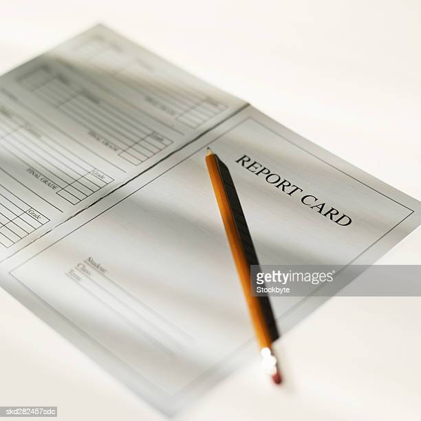 close-up of school report and pencil - report card stock photos and pictures