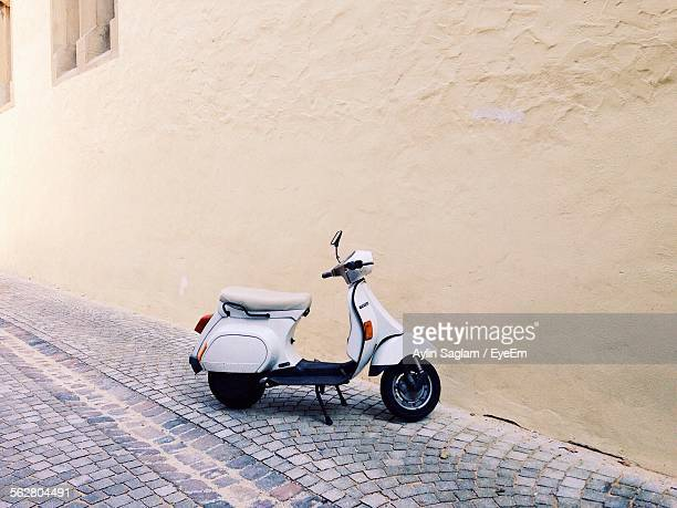 Close-Up Of Scooter In Street