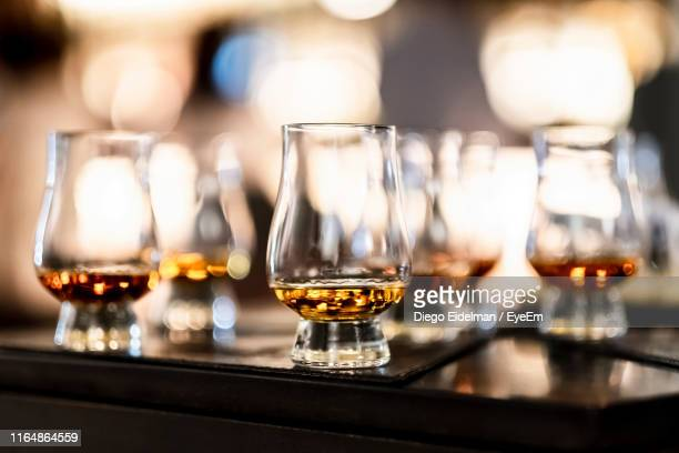 close-up of scotch whiskey in glass on table - scotch whiskey stock pictures, royalty-free photos & images