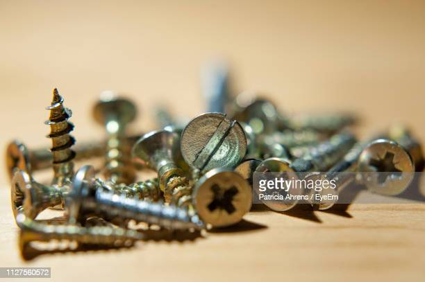 Close-Up Of Screw On Table