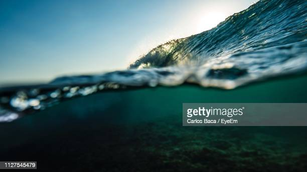 close-up of sea against sky - underwater stock pictures, royalty-free photos & images