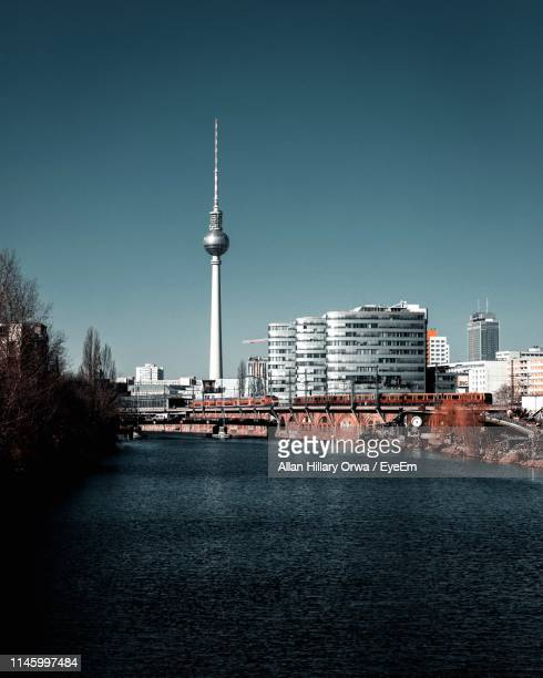 close-up of sea and buildings against clear sky - berlin stock pictures, royalty-free photos & images