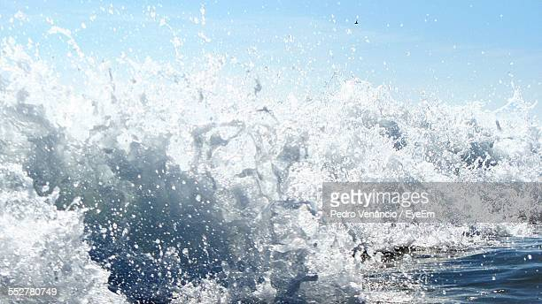Close-Up Of Sea Waves Against Sky