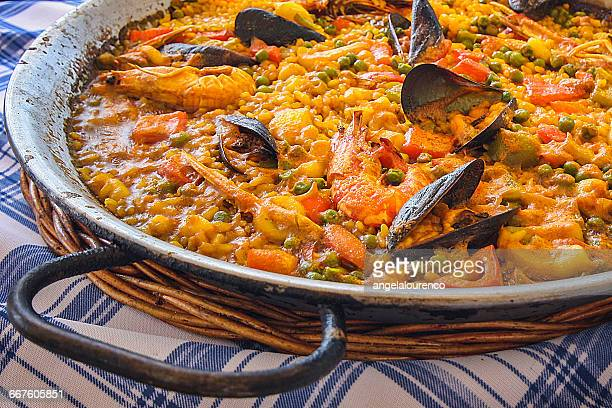 close-up of seafood paella - paella stock photos and pictures