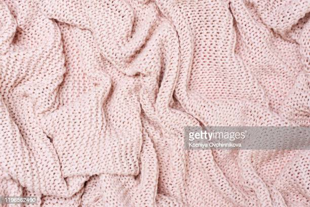 closeup of seamless pink knitted fabric texture - wool stock pictures, royalty-free photos & images