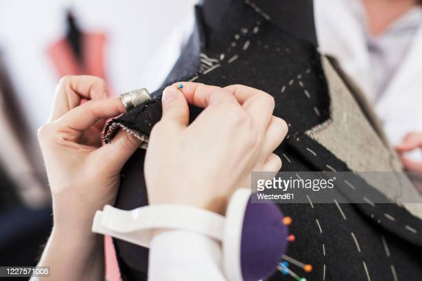 close-up of seamstress pinning suit jacket - customized stock pictures, royalty-free photos & images