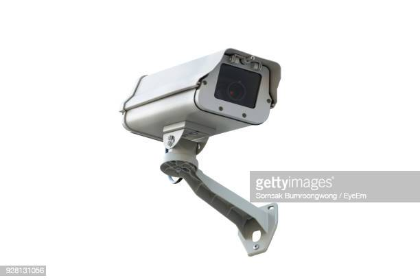 close-up of security camera against white background - surveillance camera stock pictures, royalty-free photos & images