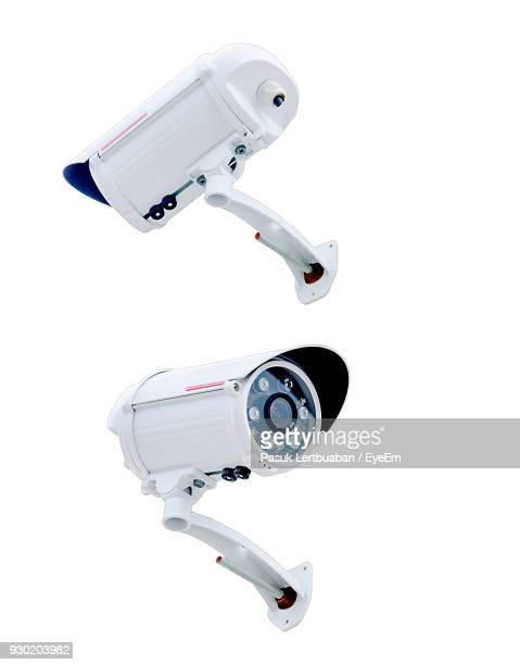 close-up of security cameras over white background - webcam stock photos and pictures