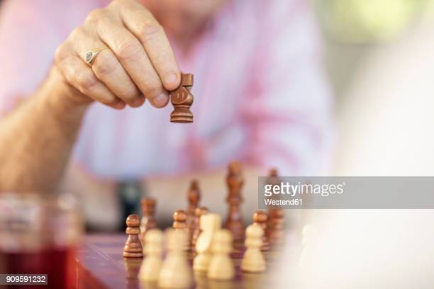 Close-up of senior couple playing chess