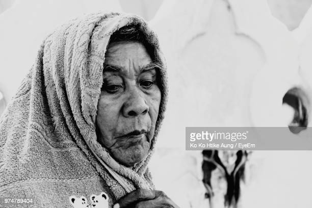 close-up of senior man covering head with towel - ko ko htike aung stock pictures, royalty-free photos & images