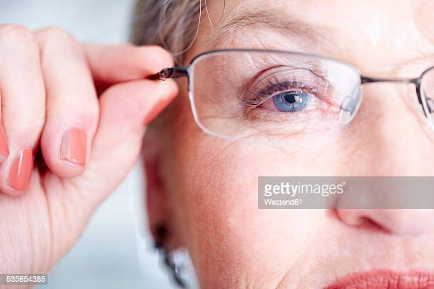 Close-up of senior woman wearing glasses