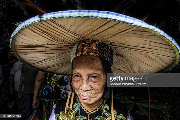 close-up of senior woman wearing large traditional hat - island of borneo stock pictures, royalty-free photos & images