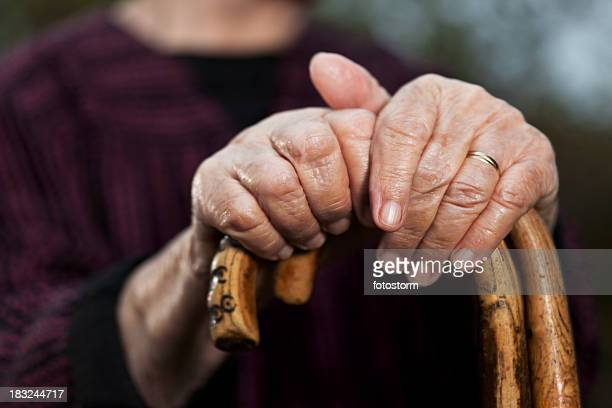 Close-up of senior woman's hands holding her walking sticks