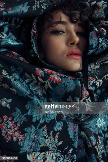 Close-up of sensual woman amidst jacket