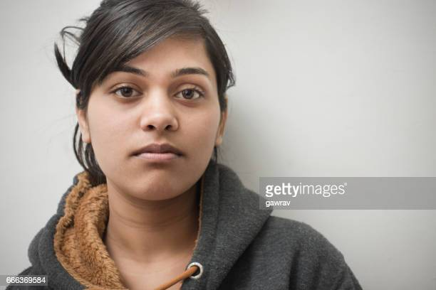 close-up of serene asian girl thinking. - indian woman stock photos and pictures