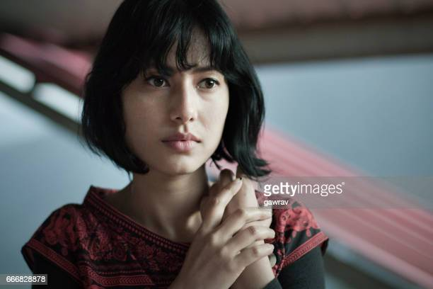 close-up of serene asian girl thinking. - short hair stock pictures, royalty-free photos & images
