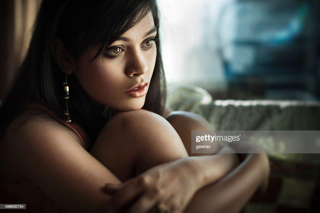 Closeup Of Serene Sad Asian Teenager Girl Sitting Near Window Stock Photo  Getty Images-9811