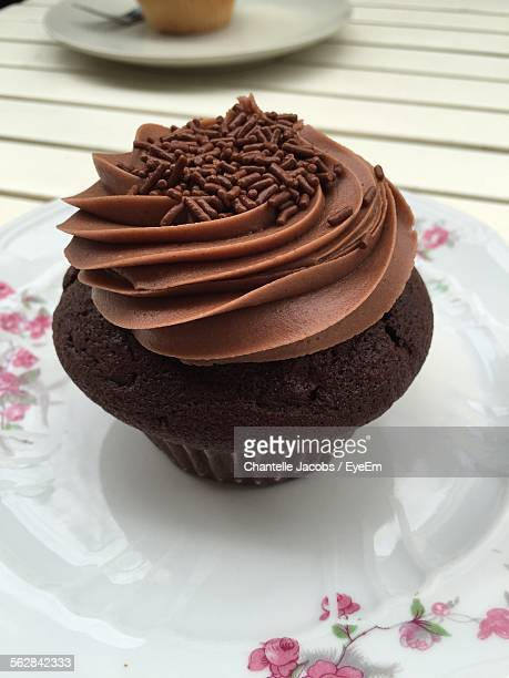 Close-Up Of Served Chocolate Cupcake In Plate