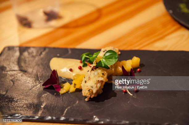 close-up of served food on stone plate - piotr hnatiuk stock pictures, royalty-free photos & images