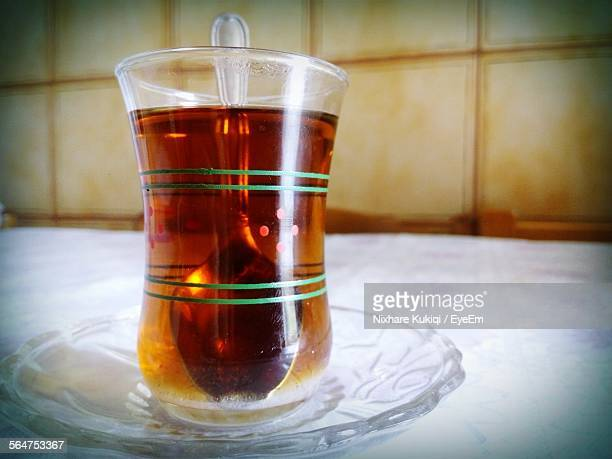Close-Up Of Served Herbal Tea Glass