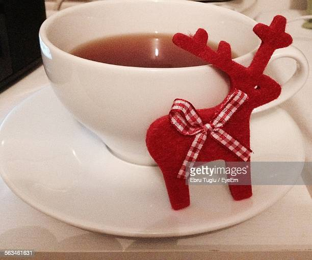 Close-Up Of Served Herbal Tea With Decorative Red Deer