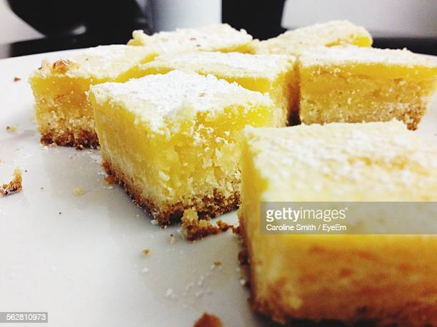 Close-Up Of Served Lemon Cake Slice In Plate