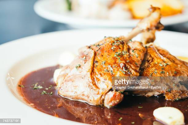 close-up of served meat in plate - gravy stock photos and pictures