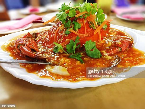 Close-Up Of Served Snow Crab With Gravy In Plate