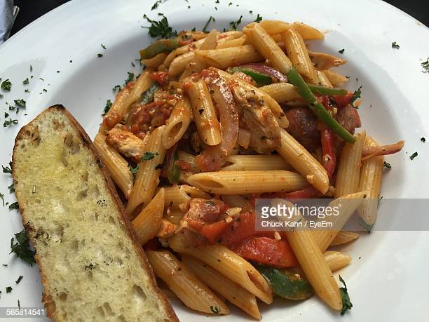 Close-Up Of Serves Pasta With Slice Of Bread In Plate