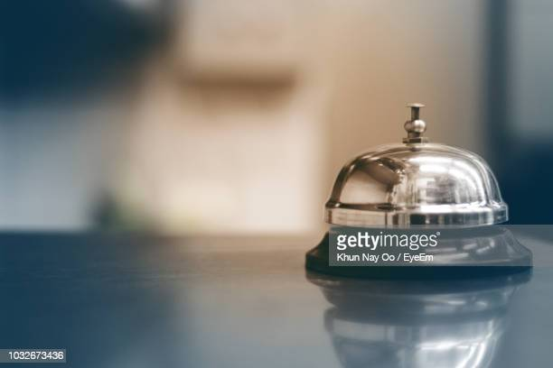 close-up of service bell on table - hotel stock pictures, royalty-free photos & images