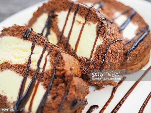 Close-Up Of Serving Brown Chocolate Cake Slices In Plate