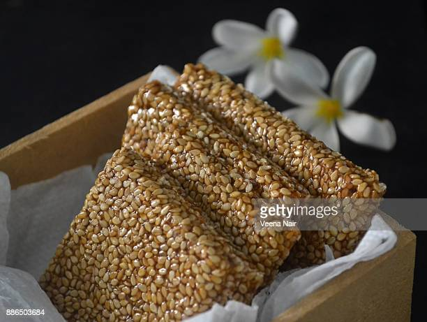 Close-up of sesame brittle/chikki in a wooden box