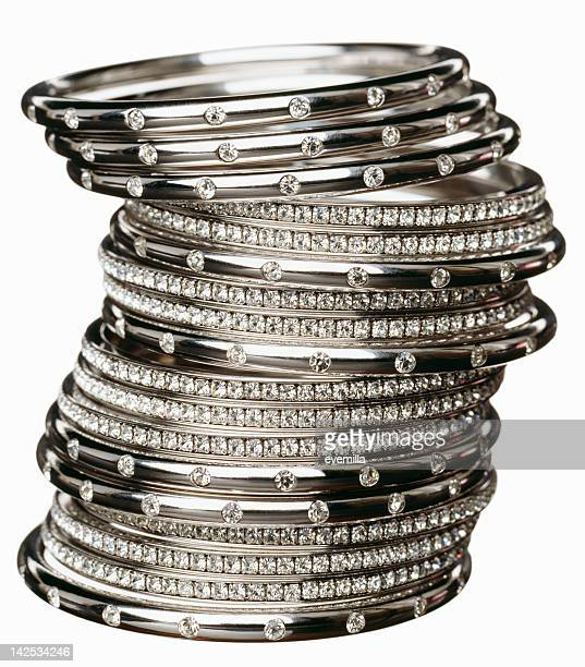 Close-up of several diamond bracelets