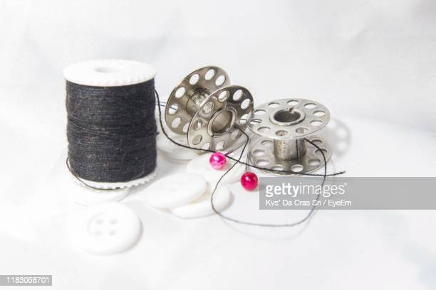 close-up of sewing item on table - button sewing item stock pictures, royalty-free photos & images
