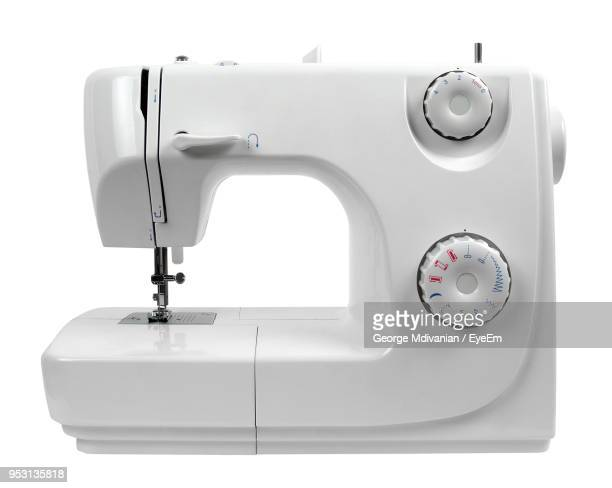 close-up of sewing machine on white background - ミシン ストックフォトと画像