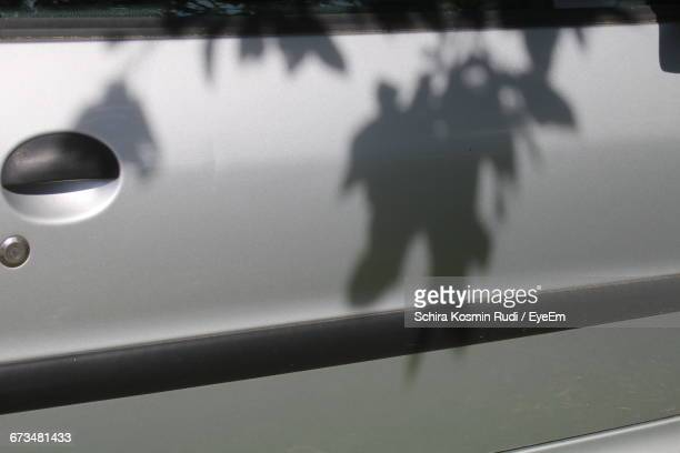 Close-Up Of Shadow On Silver Car