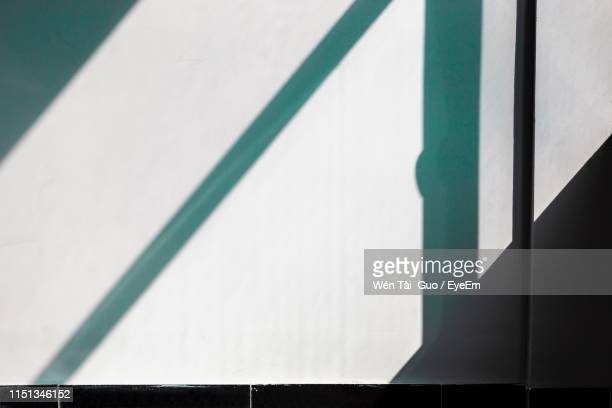 close-up of shadow on wall - shadow stock pictures, royalty-free photos & images