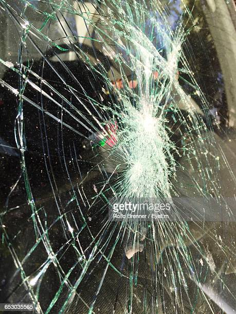 Close-Up Of Shattered Car Windshield